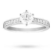 Canadian Ice brilliant cut 0.65 total carat weight solitaire and diamond set shoulders ring set in 18 carat white gold