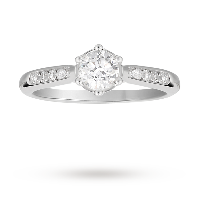 Brilliant cut 0.60 total carat weight diamond solitaire and diamond set shoulders ring in platinum